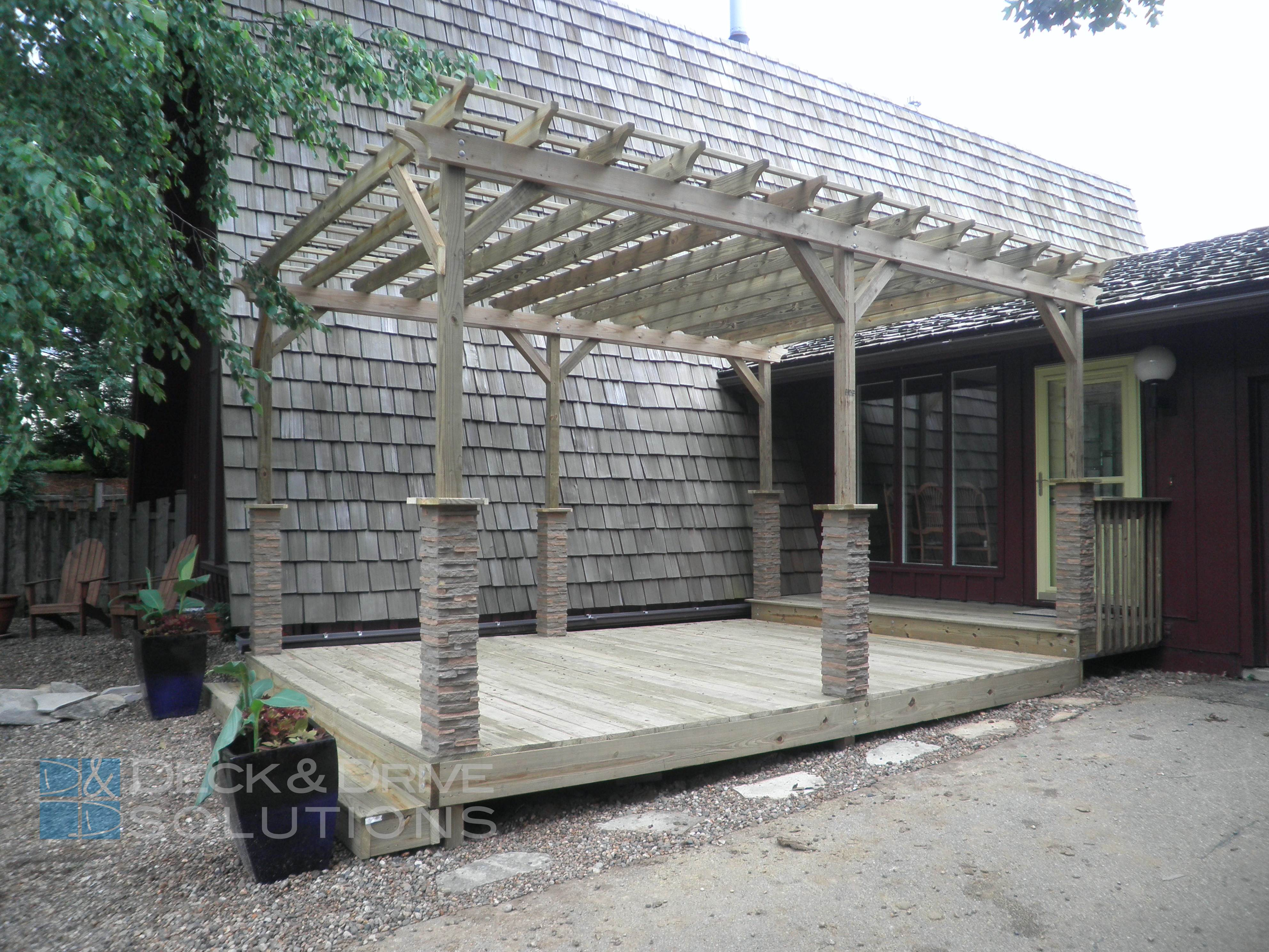 Front Porch And Pergola With Stone Wrapped Posts Des