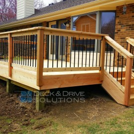 Deck Resurface with Cedar and Cedar Post Rail with Round Metal Spindles