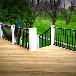 Treated Deck with Black Westbury Railing and White Posts