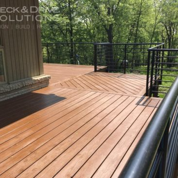 Bark Mulch Stain with Black Metal Railing