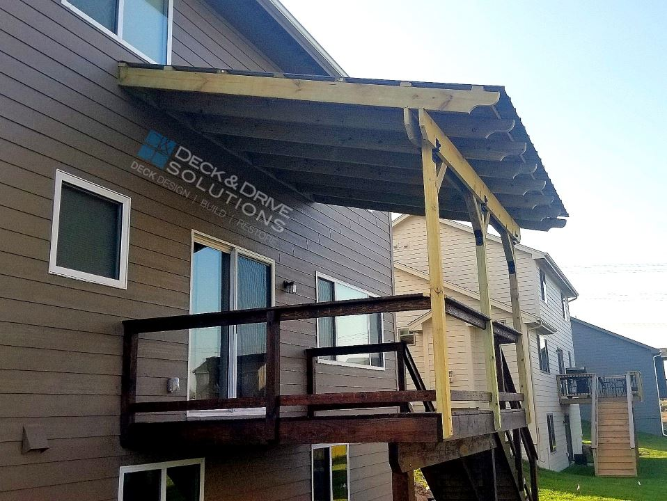 Metal roof over deck des moines deck builder deck and for Metal roof porch pictures