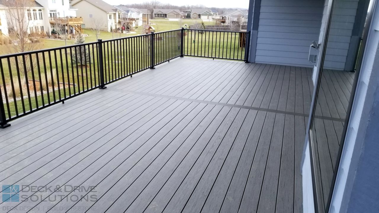 Timbertech silver maple walkout des moines deck builder for Capped composite decking