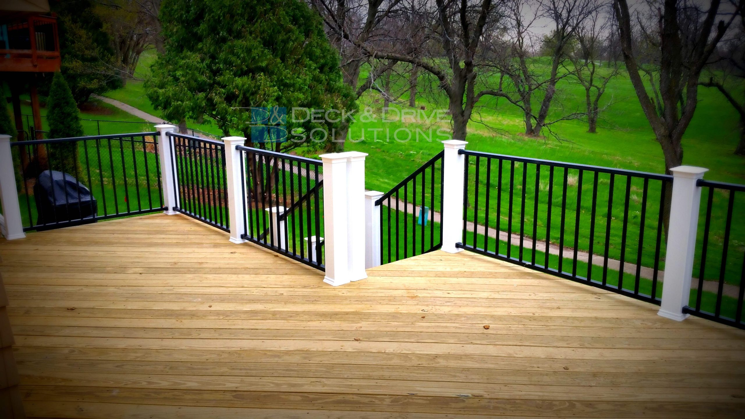 Treated Deck with Black Westbury Railing and White Posts ...