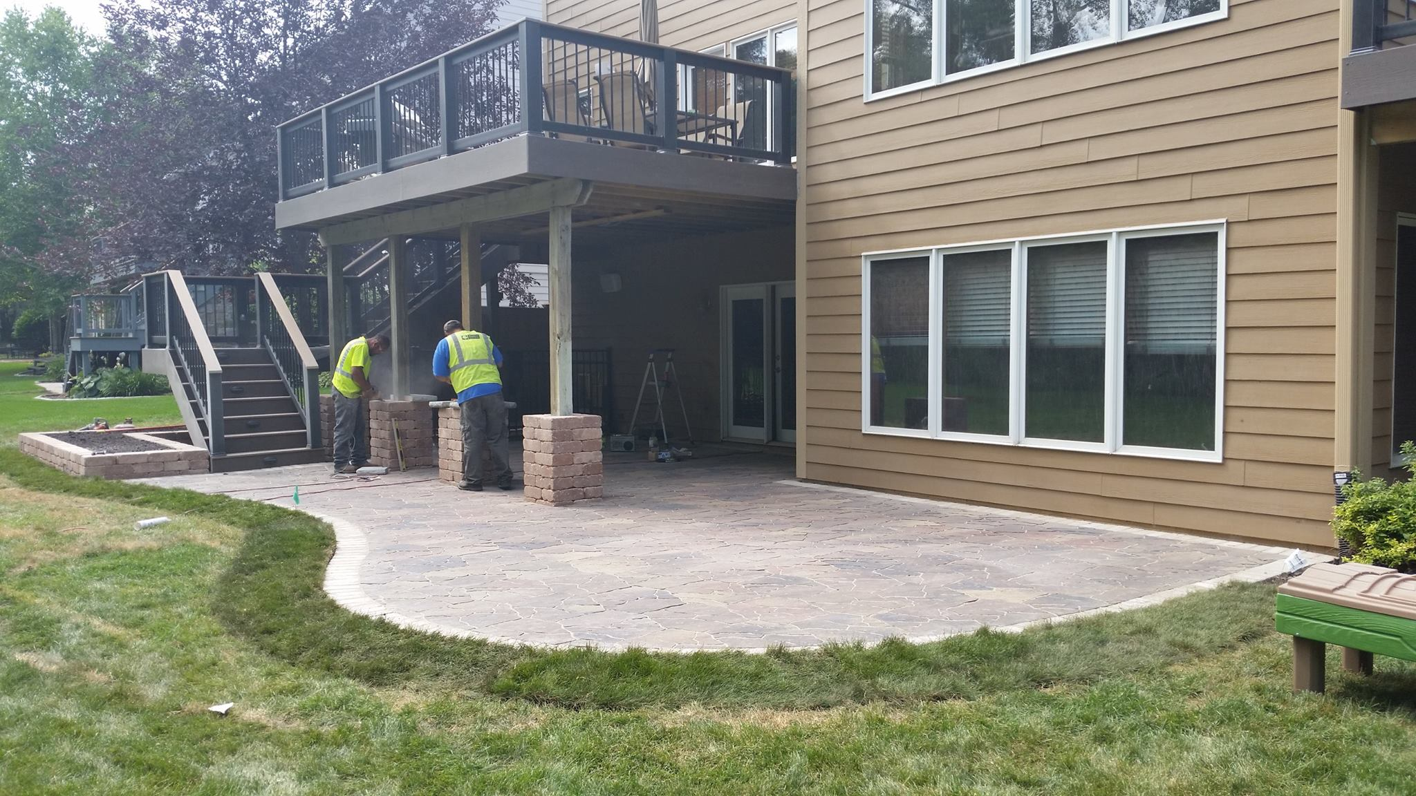 Double Decks Under Deck System And New Stone Patio Des Moines Builder Drive Solutions